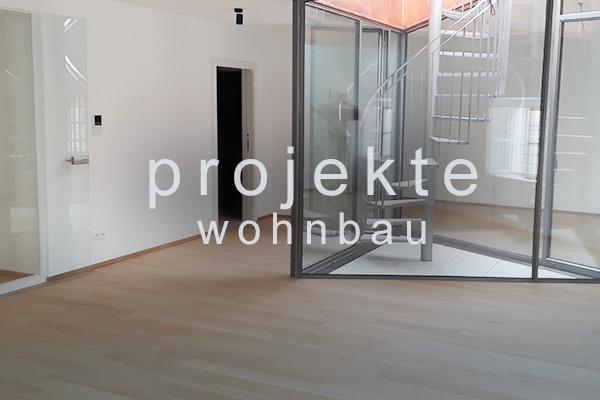 <strong>Projekte Wohnbau<span></span></strong><i>→</i>